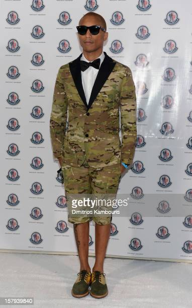 Producer Pharrell Williams attends a private dinner celebrating Remo Ruffini and Moncler's 60th Anniversary during Art Basel Miami Beach on December...