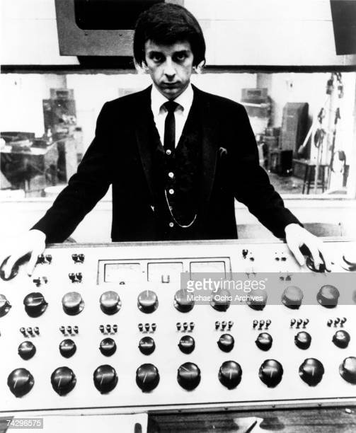 Producer Phil Spector poses at the mixing board during a recording session at Gold Star Studios in 1966 in Los Angeles, California.
