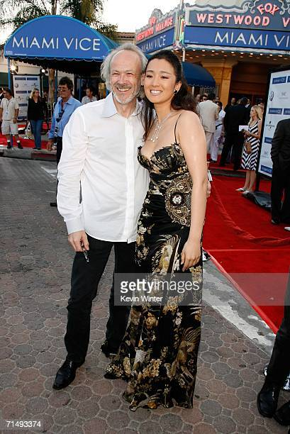 Producer Pieter Jan Brugge and actress Gong Li arrive at the Universal Pictures premiere of Miami Vice held at the Mann's Village Theatre on July 20...