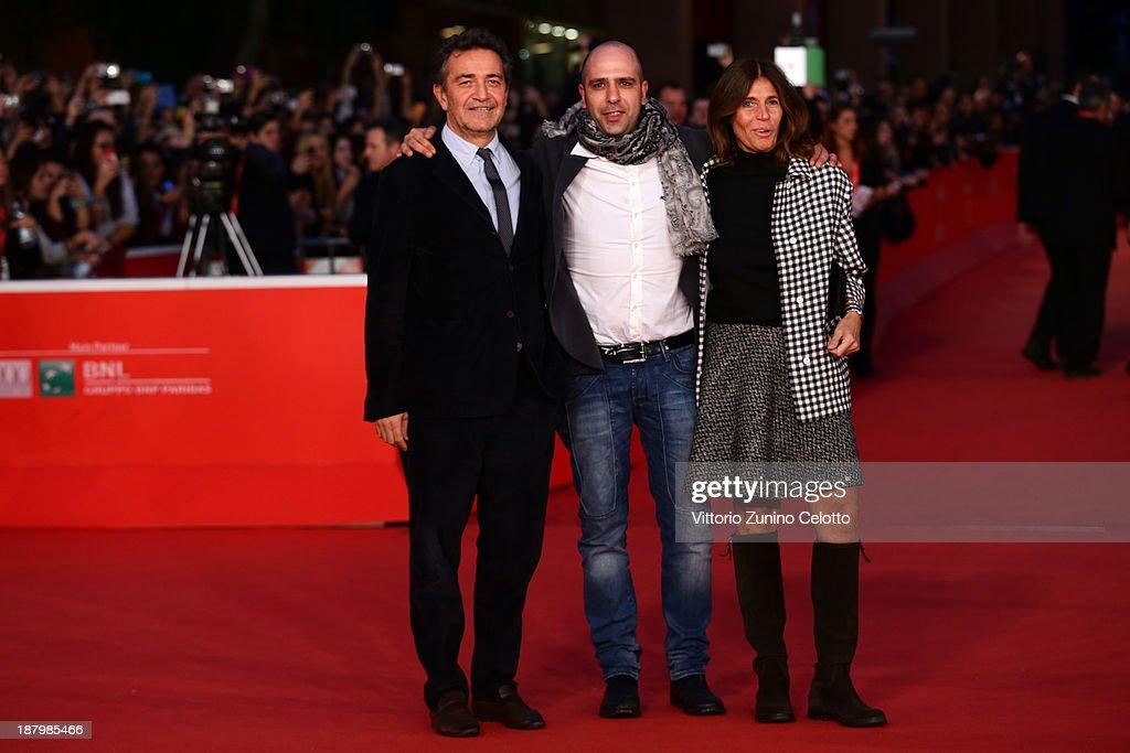 Producer Pietro Valsecchi (L), Checco Zalone and Camilla Nesbitt attend the 'Checco Zalone' Premiere during The 8th Rome Film Festival at Auditorium Parco Della Musica on November 14, 2013 in Rome, Italy.