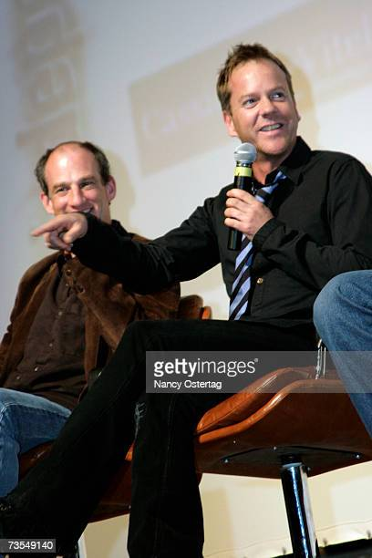 Producer Pliny Porter looks on as actor Kiefer Sutherland speaks at the DC Independent Film Festival's screening of 'I Trust You To Kill Me' at the...