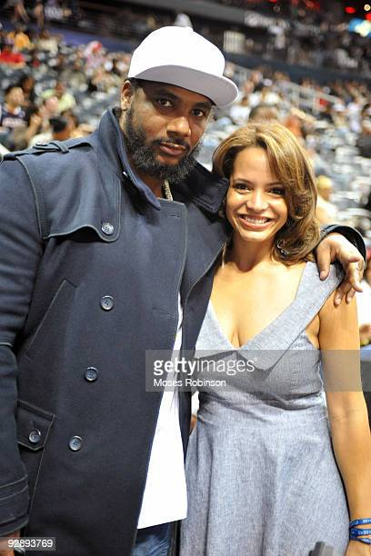 Producer Polow da Don and radio personality Elle Duncan attend the Denver Nuggets game against the Atlanta Hawks at Philips Arena on November 7 2009...