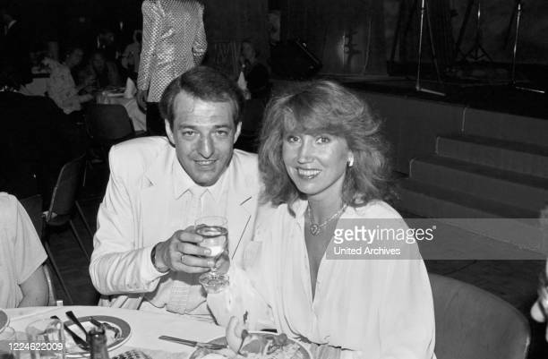 """Producer Ralph Siegel with schlager singer Ireen Sheer when German band """"Dschinghis Khan"""" receives the Golden Record at Holiday Inn hotel Munich,..."""