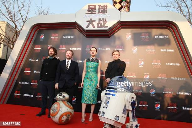 Producer Ram Bergman director Rian Johnson actress Daisy Ridley and actor Mark Hamill arrive at the premiere of film 'Star Wars The Last Jedi' at...