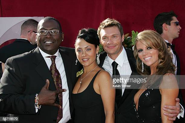 Producer Randy Jackson his guest TV personality Ryan Seacrest and Shana Wall arrive at the 57th Annual Emmy Awards held at the Shrine Auditorium on...