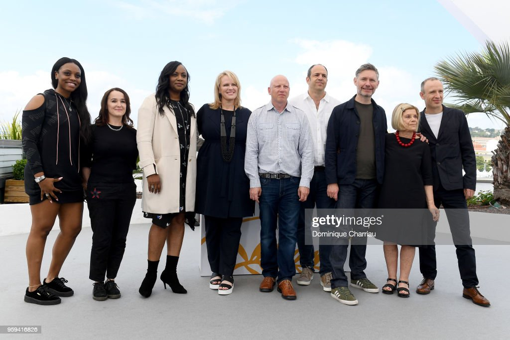 Producer Rayah Houston, producer Vanessa Tovell, producer Pat Houston, producer Lisa Erspamer, Jonathan Chinn, Simon Chinn, director Kevin Macdonald, producer Nicole David and editor Sam Rice-Edwards attend the photocall for the 'Whitney' during the 71st annual Cannes Film Festival at Palais des Festivals on May 17, 2018 in Cannes, France.