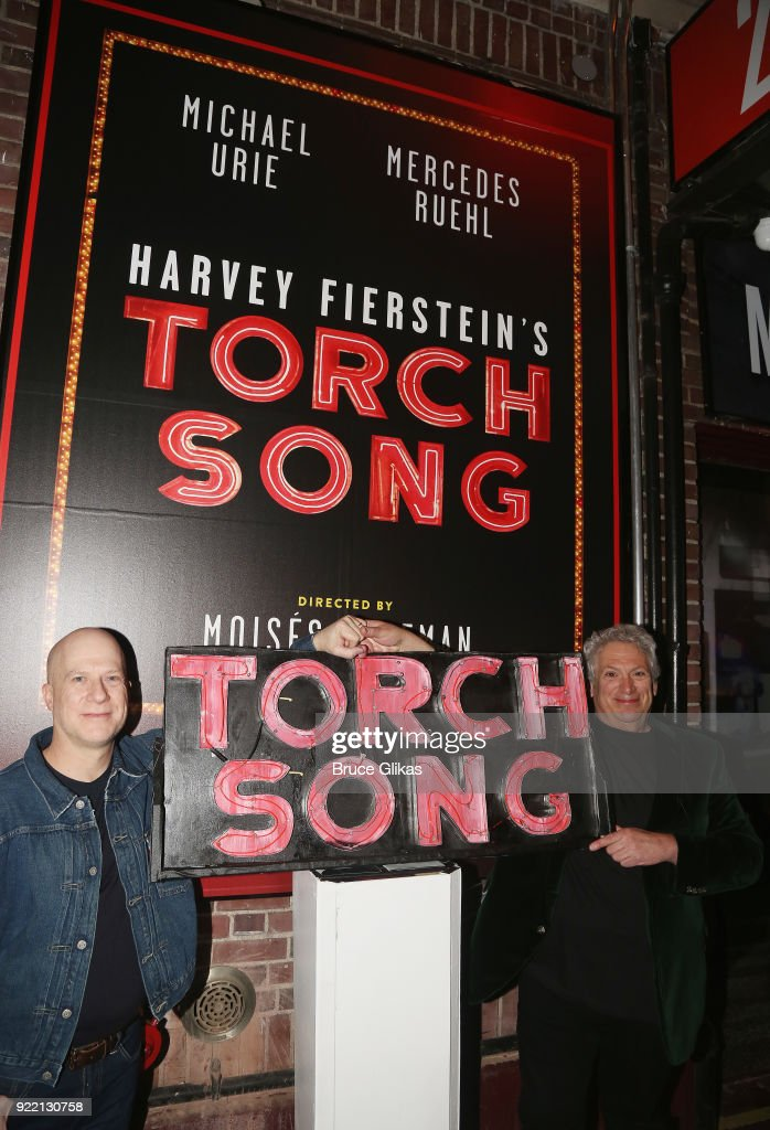 Producer Richie Jackson and Harvey Fierstein pose as Playwright Harvey Fierstein carries 'the torch' from the Second Stage Tony Kiser Theater to the Helen Hayes Theater where it debuted 36 years ago as Harvey Fierstein's iconic play 'Torch Song' announces its broadway transfer on February 20, 2018 in New York City.