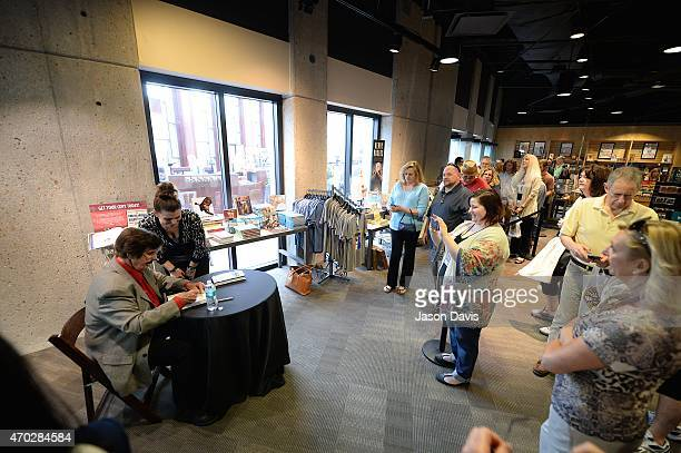 Producer Rick Hall signs copies of his book in 'The Museum Store' at 'The Man From Muscle Shoals Rick Hall in Conversation with Peter Guralnick' at...