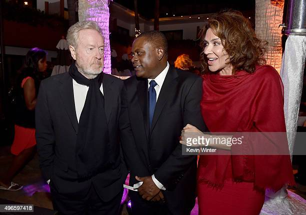 Producer Ridley Scott Dr Bennet Omalu and producer Giannina Scott attend the after party for the Centerpiece Gala Premiere of Columbia Pictures'...