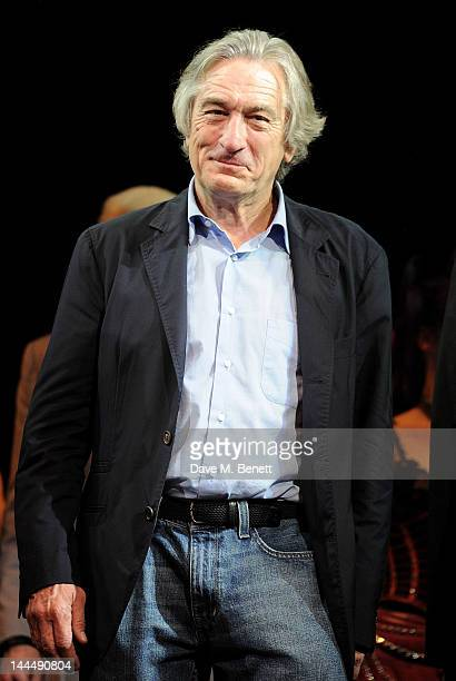 Producer Robert De Niro bows at the curtain call during the We Will Rock You 10 Year Anniversary Celebration performance at The Dominion Theatre on...