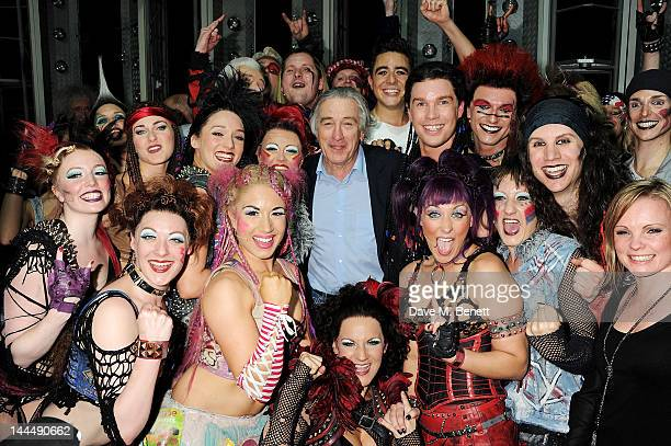 Producer Robert De Niro celebrates with cast backstage after the We Will Rock You 10 Year Anniversary performance at The Dominion Theatre on May 14,...
