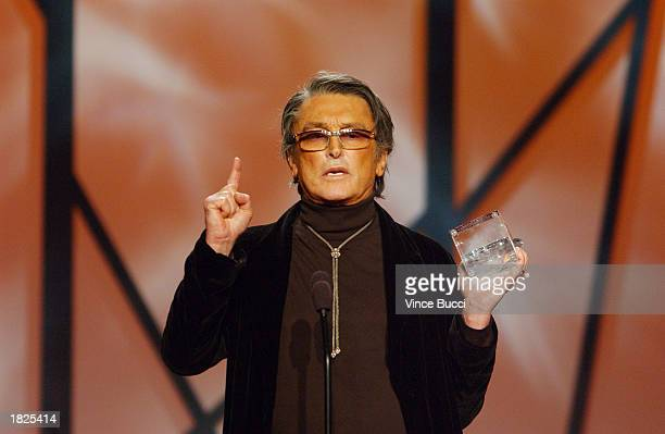 Producer Robert Evans accepts an award during the 14th Annual Producers Guild Awards at the Century Plaza Hotel on March 2 2003 in Los Angeles...