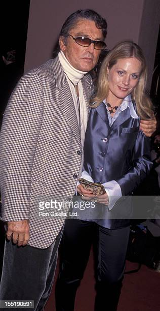 Producer Robert Evans and Beverly D'Angelo attend Art Cooper Party for Peter Bart on December 12 1995 at the Beverly Hills Hotel in Beverly Hills...