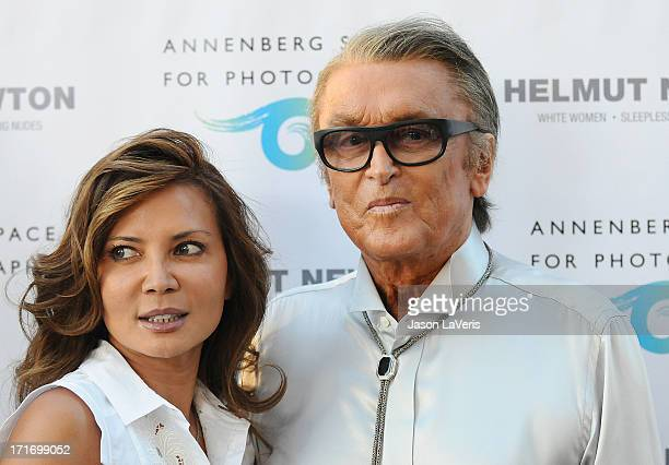 Producer Robert Evans and guest attend the opening of 'Helmut Newton White Women Sleepless Nights Big Nudes' at Annenberg Space For Photography on...