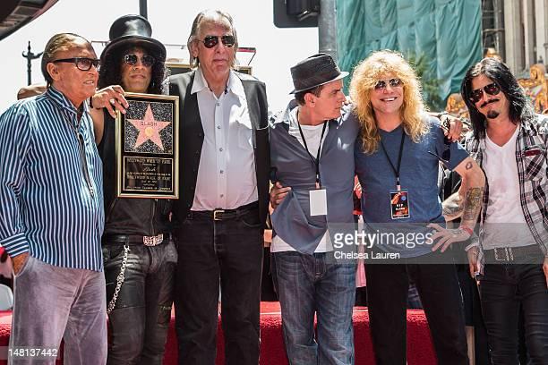 Producer Robert Evans guitarist Slash DJ Jim Ladd actor Charlie Sheen drummer Steven Adler and guitarist Gilby Clarke attend Slash's Hollywood Walk...