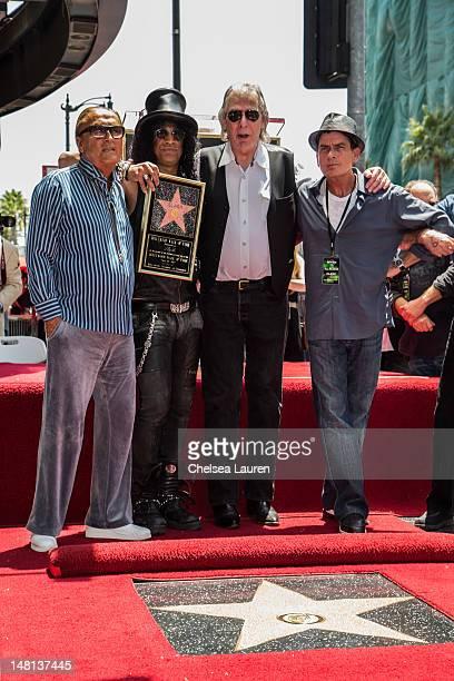 Producer Robert Evans guitarist Slash DJ Jim Ladd Actor Charlie Sheen attend Slash's Hollywood Walk of Fame ceremony on July 10 2012 in Hollywood...