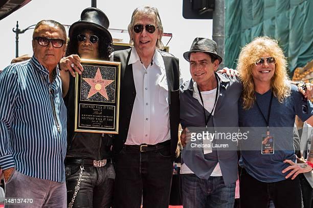 Producer Robert Evans guitarist Slash DJ Jim Ladd actor Charlie Sheen and drummer Steven Adler attend Slash's Hollywood Walk of Fame ceremony on July...