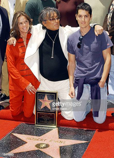 Producer Robert Evans poses with exwife actress Ali MacGraw and son Josh as they attend a ceremony honoring Evans with a star on the Hollywood Walk...