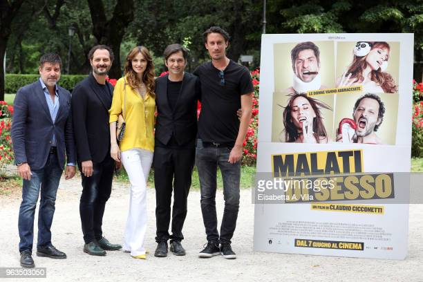 Producer Roberto Capua actors Fabio Troiano Gaia Bermani Amaral Francesco Apolloni and director Claudio Cicconetti attend 'Malati Di Sesso' photocall...