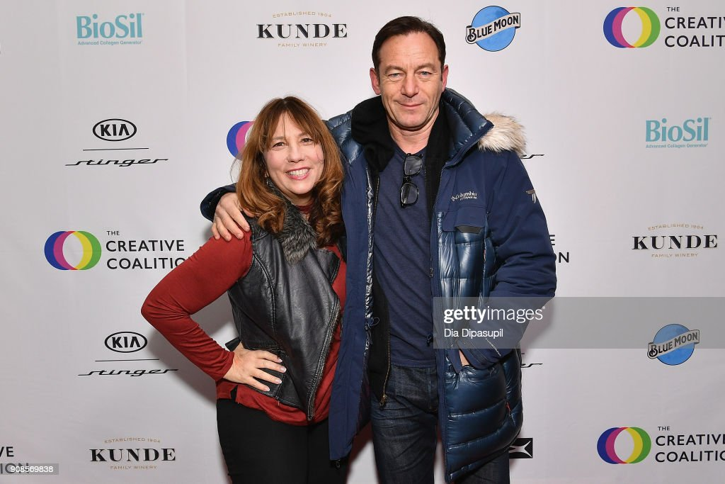 Producer Robin Bronk (L) and actor Jason Isaacs attend the 2018 Spotlight Initiative Awards Gala Dinner at Kia Supper Suite on January 21, 2018 in Park City, Utah.