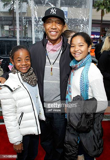 Producer Russell Simmons and daughters Aoki Lee and Ming Lee attend the 'Mirror Mirror' premiere at Grauman's Chinese Theatre on March 17 2012 in...