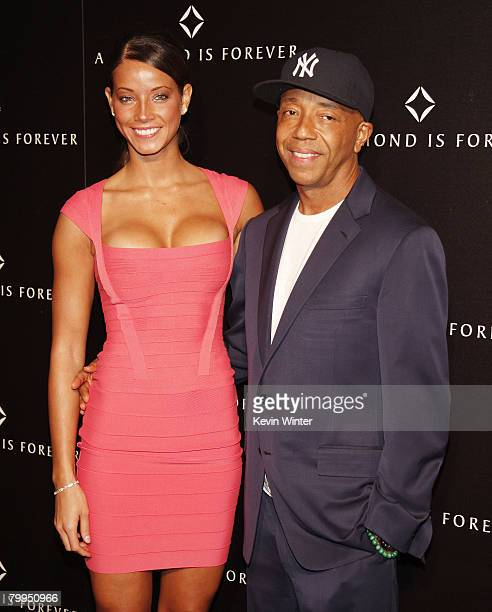 Producer Russell Simmons and model Porschla Coleman arrive at a private dinner hosted by The Diamond Information Center and Julianne Moore at the...