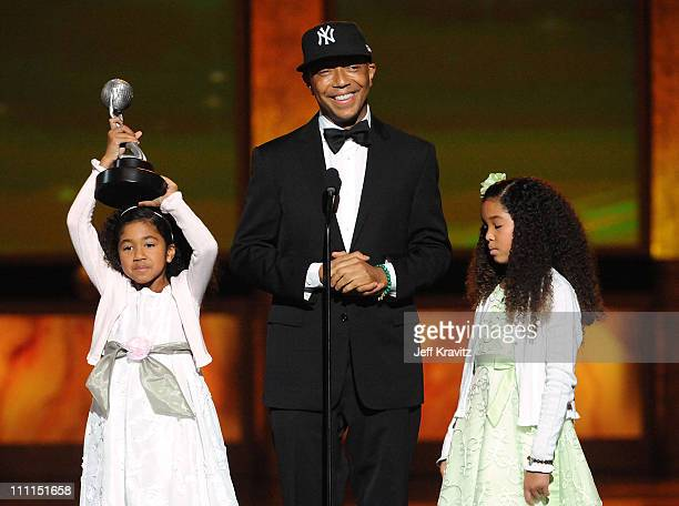 Producer Russell Simmons Aoki Lee Simmons and Ming Lee Simmons onstage at the 40th NAACP Image Awards held at the Shrine Auditorium on February 12...