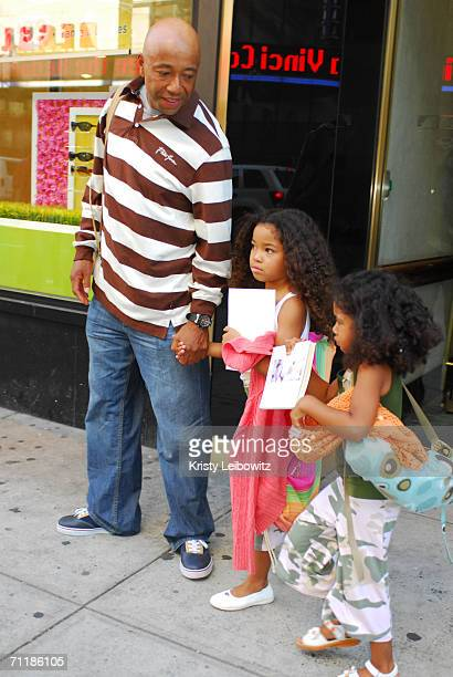 Producer Russell Simmons leaves Jivamukti Yoga on Broadway with his two daughters Ming Lee and Aoki Lee June 11 2006 in New York City