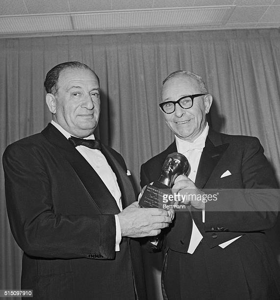 Producer Sam Spiegel receives the Irving Thalberg Memorial Award from Arthur Freed at the 36th Annual Academy Awards presentation here 4/13