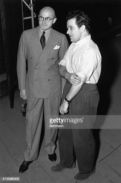Producer Samuel Goldwyn drops in on director William Wyler to see how the filming of Dead End is getting along