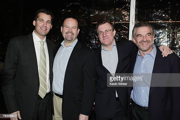 Producer Scott Stuber Universal's Marc Shmuger David Linde and producer Charles Castaldi pose at the premiere of Universal's Welcome Home Roscoe...