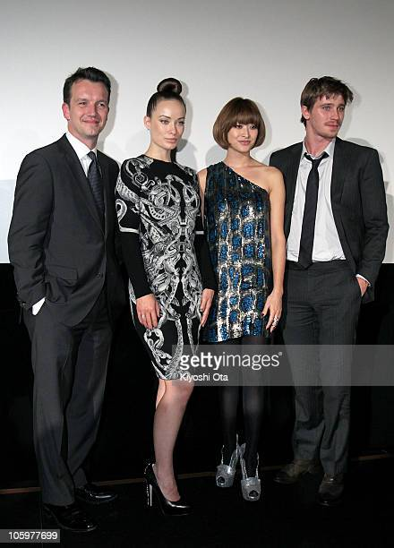 Producer Sean Bally actress Olivia Wilde model Yu Yamada and actor Garrett Hedlund pose during the 'Tron Legacy' 3D special presentation as part of...