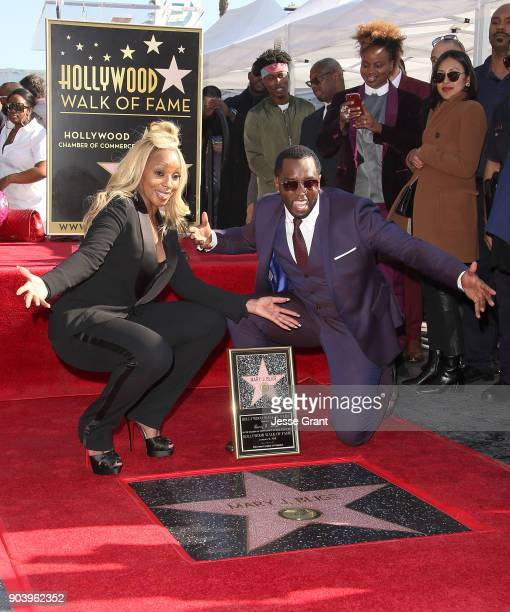 Producer Sean 'Diddy' Combs and recording artist Mary J Blige attend the ceremony honoring Mary J Blige with a Star on The Hollywood Walk of Fame on...