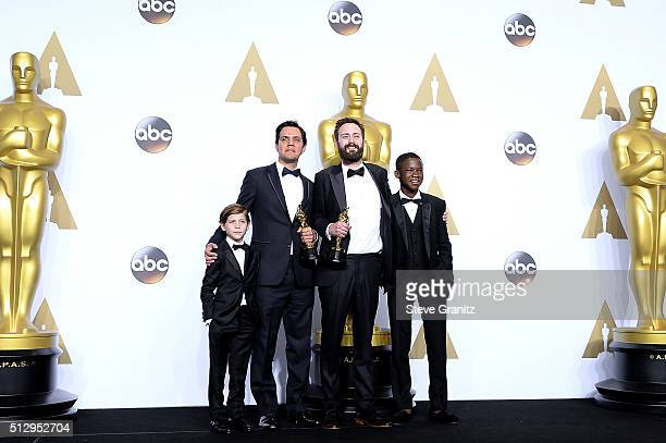 Producer Shan Christopher Ogilvie and director Benjamin Cleary , winners of the Best Live Action Short award for 'Stutterer,' pose with actors Jacob...