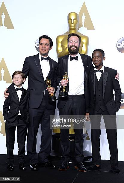 Producer Shan Christopher Ogilvie and director Benjamin Cleary winners of the Best Live Action Short award for 'Stutterer' pose with actors Jacob...