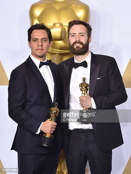 Producer Shan Christopher Ogilvie and director Benjamin Cleary , winners of the Best Live Action Short award for 'Stutterer pose in the press room...