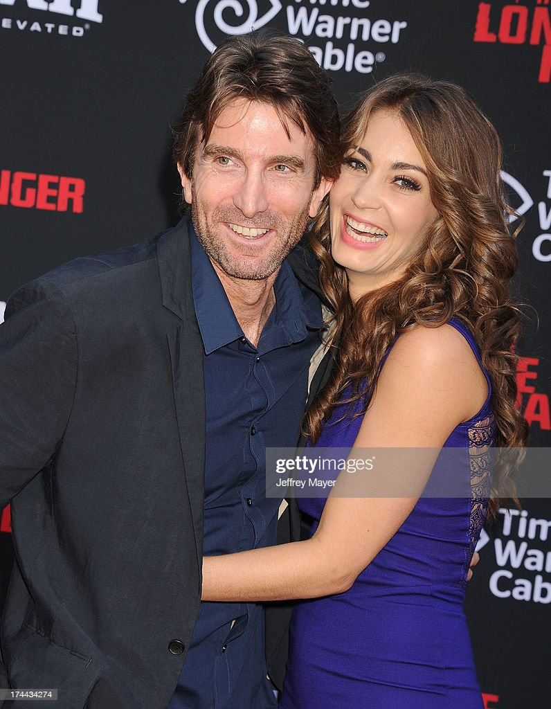 Producer Sharlto Copley and model Tanit Phoenix arrive at 'The Lone Ranger' World Premiere at Disney's California Adventure on June 22, 2013 in Anaheim, California.