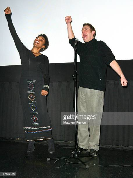 Producer Sherry Simpson and director Lee Hirsch yell AMANDLA during the New York premiere of Artisan's Amandla A Revolution In Four Part Harmony at...