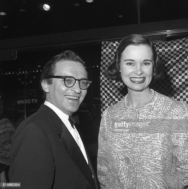 "Producer Sidney Lumet and his wife, heiress Gloria Vanderbilt smile as the stand together at the Astor Theatre for the opening of ""The Fugitive..."