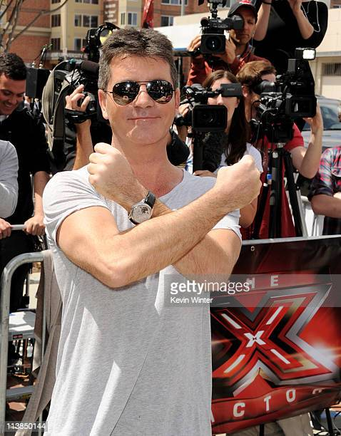 """Producer Simon Cowell arrives at the first round of auditions for Fox's """"The X Factor"""" at Galen Center on May 8, 2011 in Los Angeles, California."""