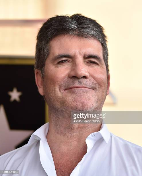 Producer Simon Cowell attends the ceremony honoring Haim Saban with star on the Hollywood Walk of Fame on March 22 2017 in Hollywood California