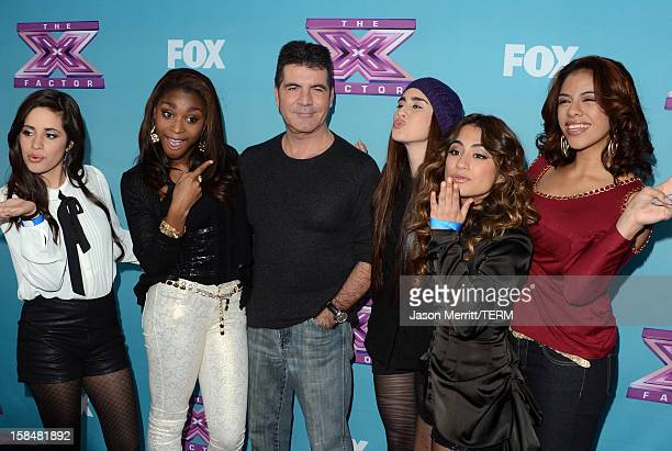 Producer Simon Cowell with X Factor contestants Fifth Harmony attend Fox's 'The X Factor' season finale news conference at CBS Television City on...