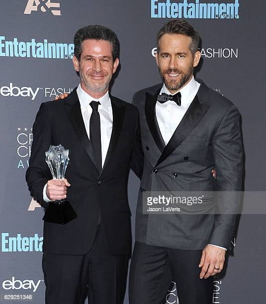 Producer Simon Kinberg and actor Ryan Reynolds pose in the press room at the 22nd annual Critics' Choice Awards at Barker Hangar on December 11 2016...