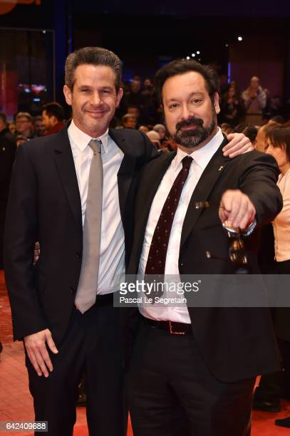 Producer Simon Kinberg and director James Mangold attend the 'Logan' premiere during the 67th Berlinale International Film Festival Berlin at...