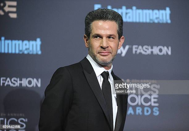 Producer Simon Kinberg poses in the press room at the 22nd annual Critics' Choice Awards at Barker Hangar on December 11 2016 in Santa Monica...