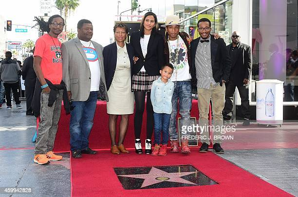 Producer singer and songwriter Pharrell Williams poses with his family beside his just unveiled Hollywood Walk of Fame Star in Hollywood California...