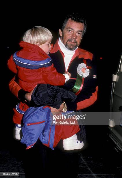 Producer Stephen Cannell and son Cody Cannell attending Hollywood Christmas Parade on December 1 1985 in Hollywood California
