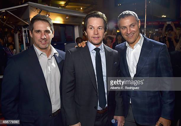 Producer Stephen Levinson actor Mark Wahlberg and talent agent Ari Emanuel attend the screening of The Gambler during the AFI FEST 2014 presented by...