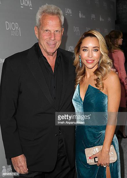 Producer Steve Tisch and Katia Francesconi attend the premiere of The Orchard's 'DIOR I' at LACMA on April 15 2015 in Los Angeles California