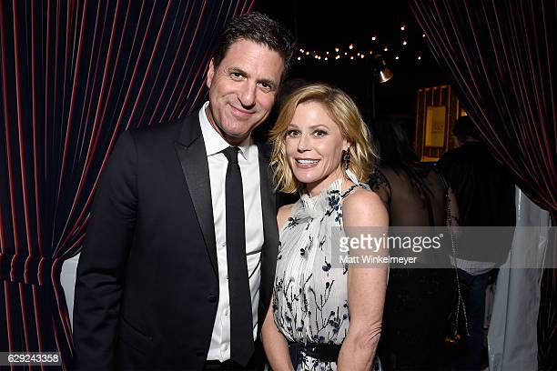 Producer Steven Levitan and actress Julie Bowen attend The 22nd Annual Critics' Choice Awards after party at Barker Hangar on December 11 2016 in...